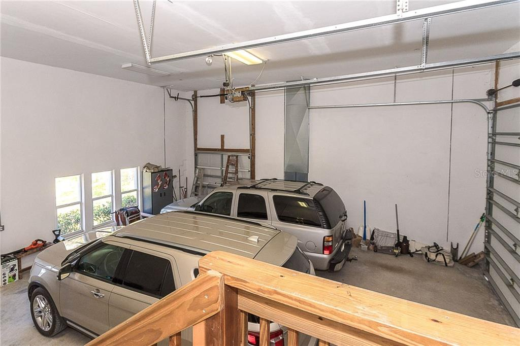 Large garage has room to park your RV or multiple cars. Chair lift offers easy access to the main living area too. - Single Family Home for sale at 550 S Oxford Dr, Englewood, FL 34223 - MLS Number is D6111512