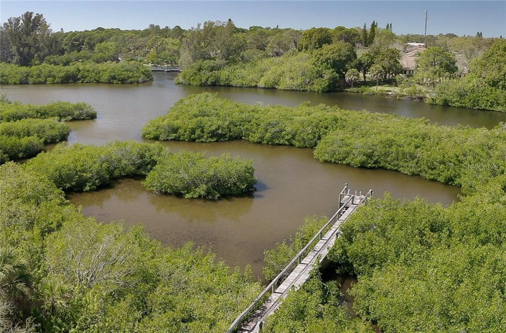 Your own private harbor where you can fish from your dock - Single Family Home for sale at 550 S Oxford Dr, Englewood, FL 34223 - MLS Number is D6111512