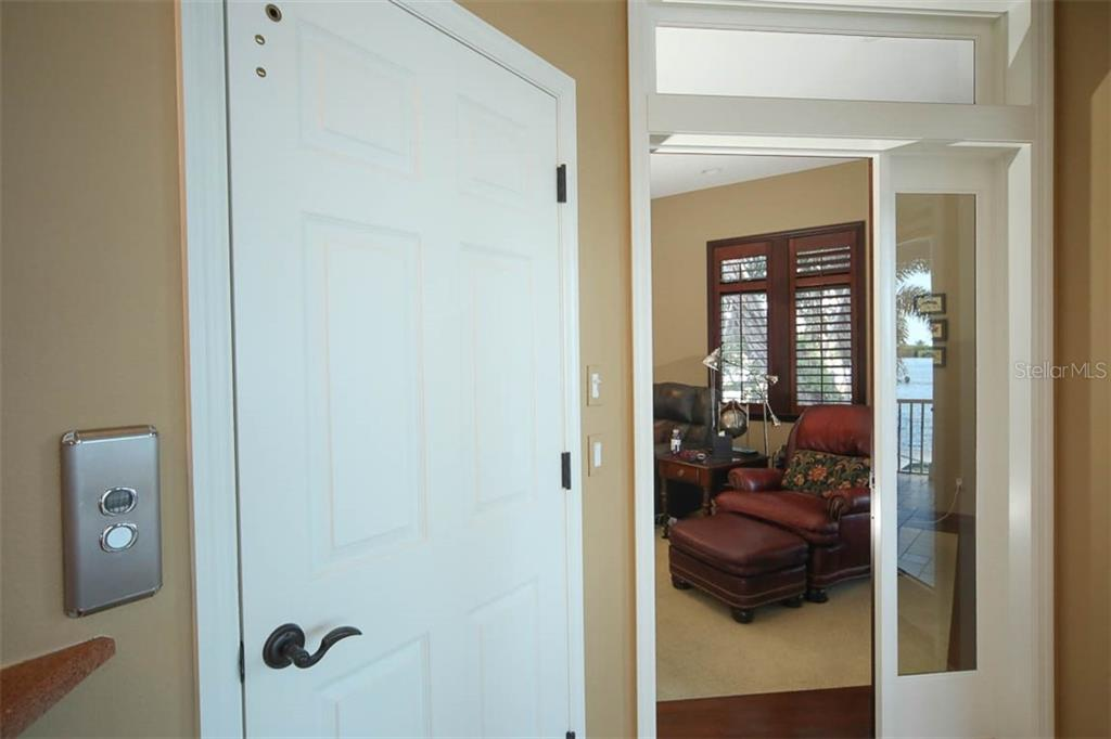 ELEVATOR FROM GARAGE! - Single Family Home for sale at 500 Anchor Row, Placida, FL 33946 - MLS Number is D6111649