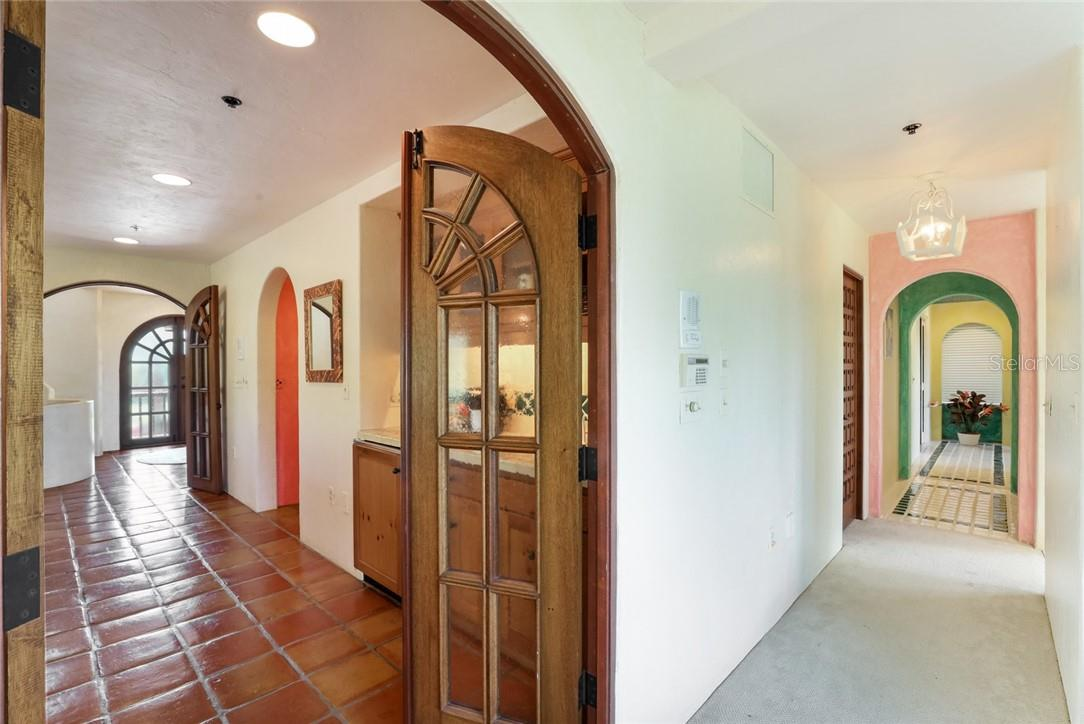 Arch and door details with hall leading to Master Bath and over-sized walk-in closets - Single Family Home for sale at 4090 Loomis Ave, Boca Grande, FL 33921 - MLS Number is D6112331