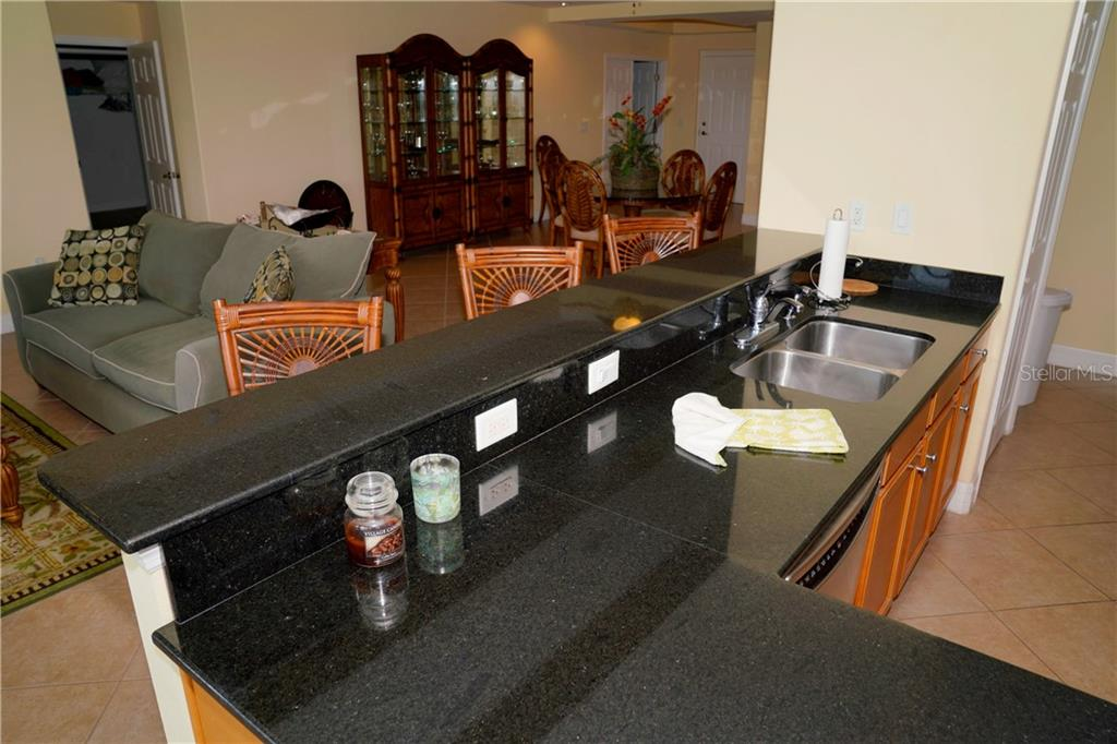 Breakfast bar w/stools - Condo for sale at 2245 N Beach Rd #304, Englewood, FL 34223 - MLS Number is D6112346