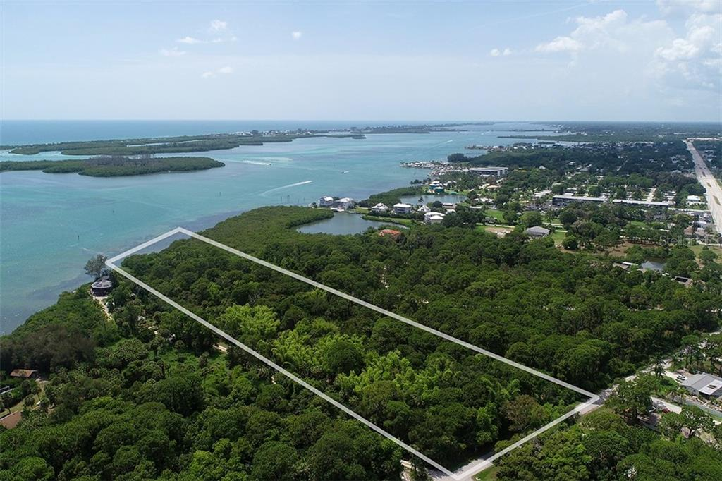 looking north - north neighbor owns 21 acres - Vacant Land for sale at 9427 Downing St, Englewood, FL 34224 - MLS Number is D6112667
