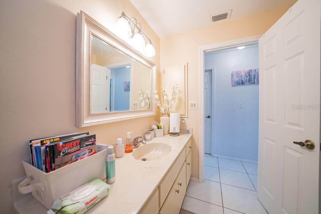 guest bathroom, pool bath - Single Family Home for sale at 408 Seasons Dr, Port Charlotte, FL 33983 - MLS Number is D6113303