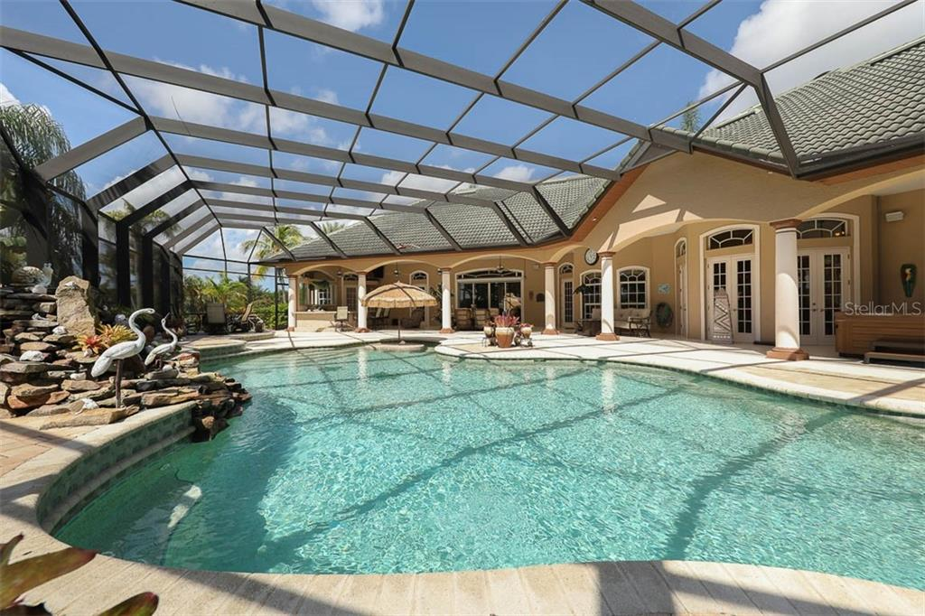 Custom Heated Salt Water Pool/Spa with Waterfall and Tropical Landscape. - Single Family Home for sale at 9300 Hialeah Ter, Port Charlotte, FL 33981 - MLS Number is D6113597