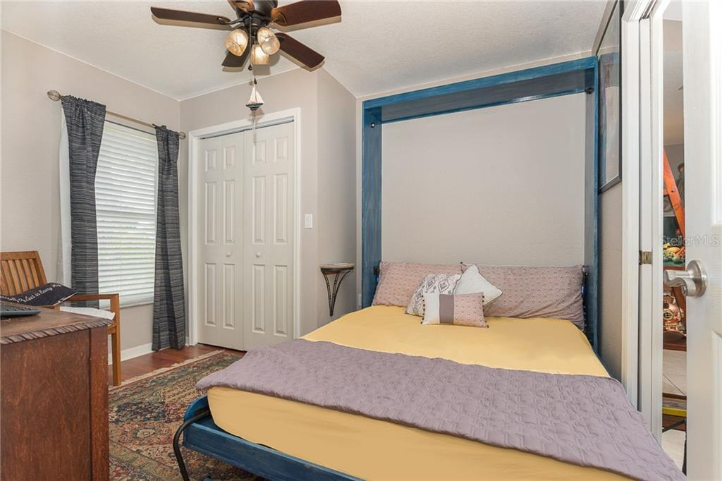 Bedroom three with Murphy bed in use - Single Family Home for sale at 185 Apollo Dr, Rotonda West, FL 33947 - MLS Number is D6113690