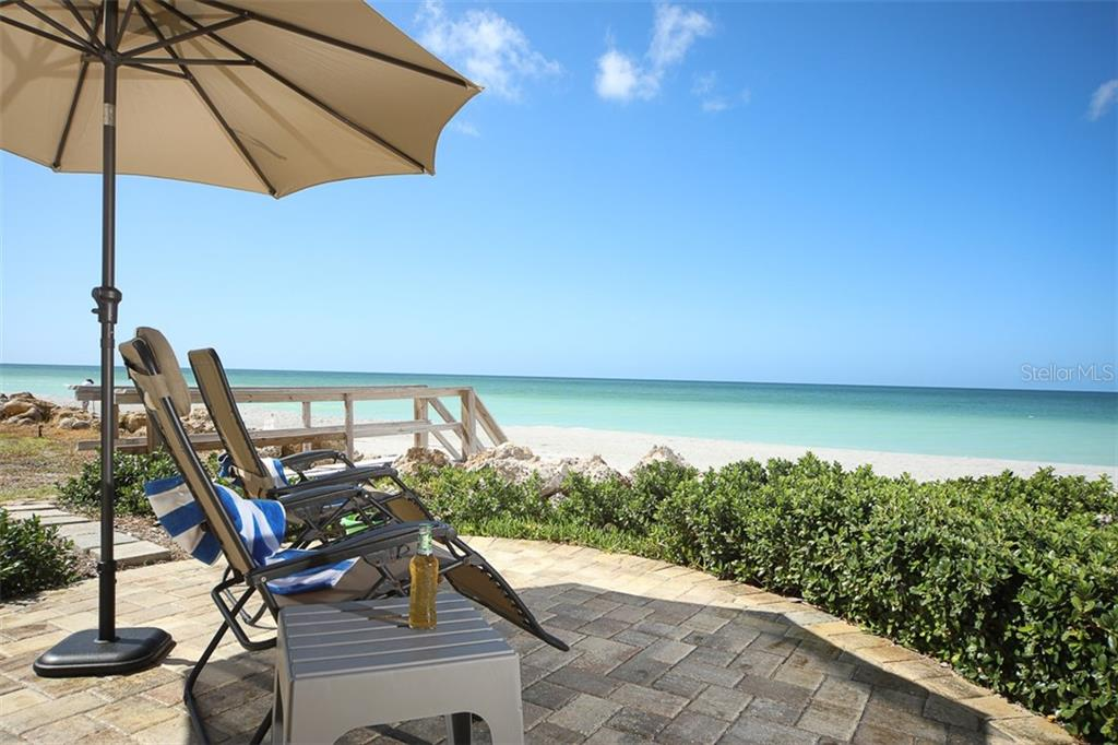 Relax on the paver patio under the umbrella with a view of the Beach & Gulf! - Single Family Home for sale at 4074 N Beach Rd #Ctg4, Englewood, FL 34223 - MLS Number is D6114111