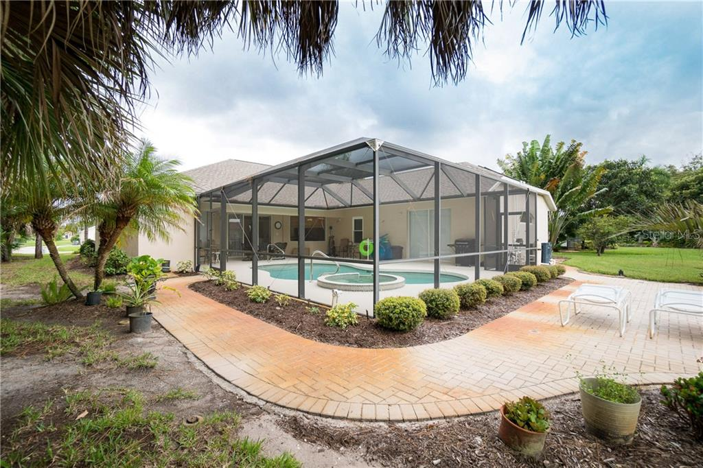 Paver patio and pool area. - Single Family Home for sale at 439 Boundary Blvd, Rotonda West, FL 33947 - MLS Number is D6114162