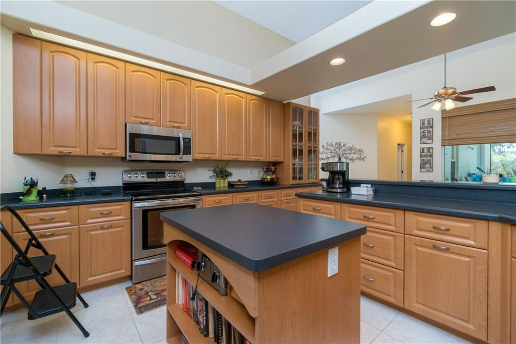Handy kitchen island for extra storage! - Single Family Home for sale at 439 Boundary Blvd, Rotonda West, FL 33947 - MLS Number is D6114162