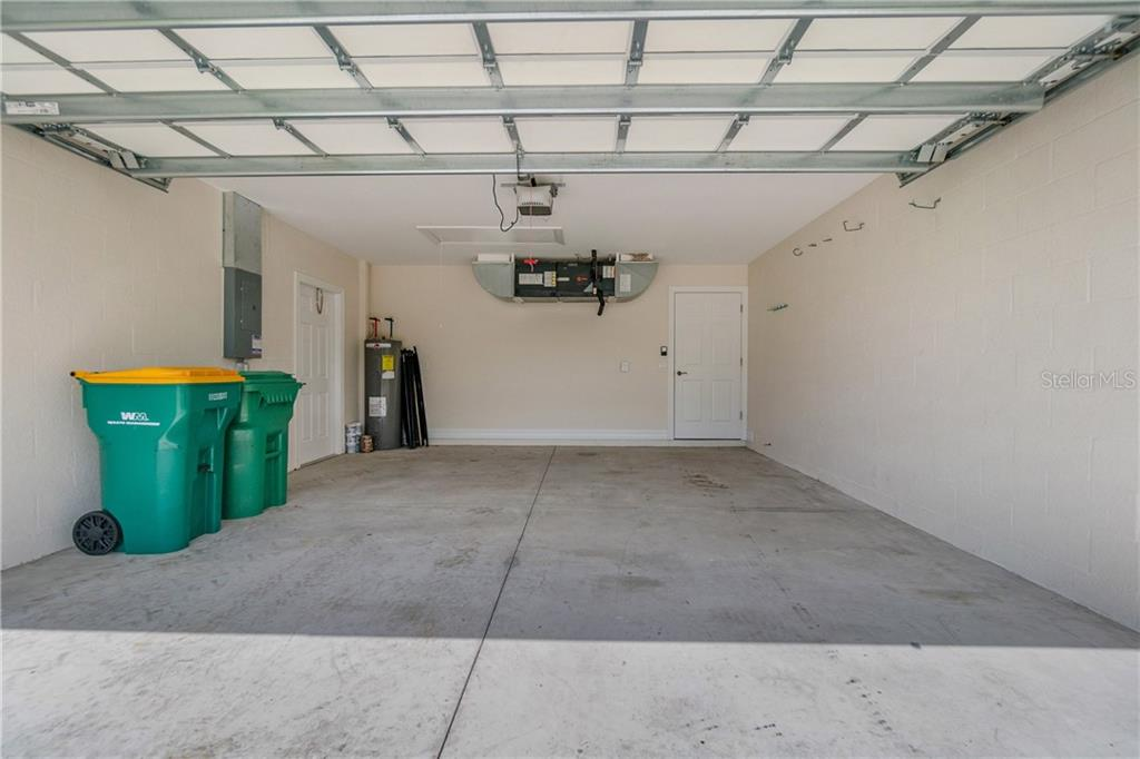 CLOSER LOOK AT THE GARAGE. THERE ARE TWO REMOTES FOR THE ELECTRIC DOOR OPENER. - Single Family Home for sale at 112 Boxwood Ln, Rotonda West, FL 33947 - MLS Number is D6114179