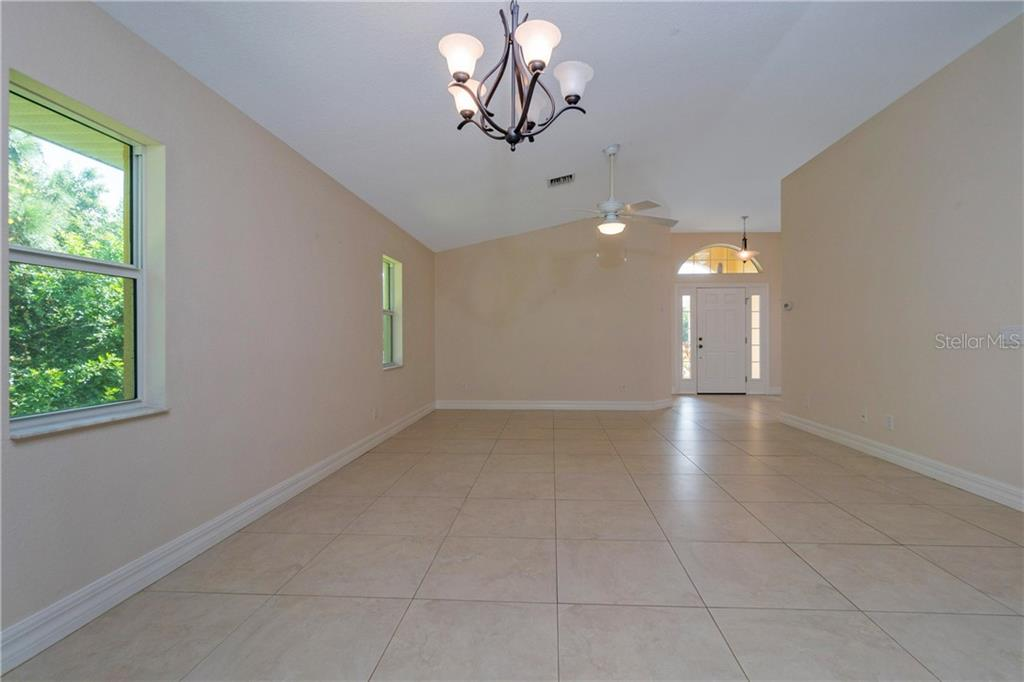 FROM THE DINING AREA OF THE GREAT ROOM LOOKING TOWARD THE FRONT ENTRY. - Single Family Home for sale at 112 Boxwood Ln, Rotonda West, FL 33947 - MLS Number is D6114179