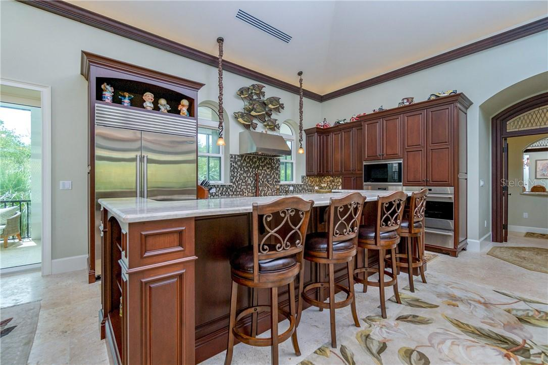 Vast breakfast bar for a casual dining experience - Single Family Home for sale at 10161 Eagle Preserve Dr, Englewood, FL 34224 - MLS Number is D6114216