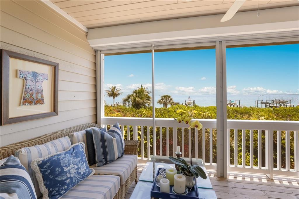 Main level porch with excellent views - Single Family Home for sale at 561 Buttonwood Bay Dr, Boca Grande, FL 33921 - MLS Number is D6114322