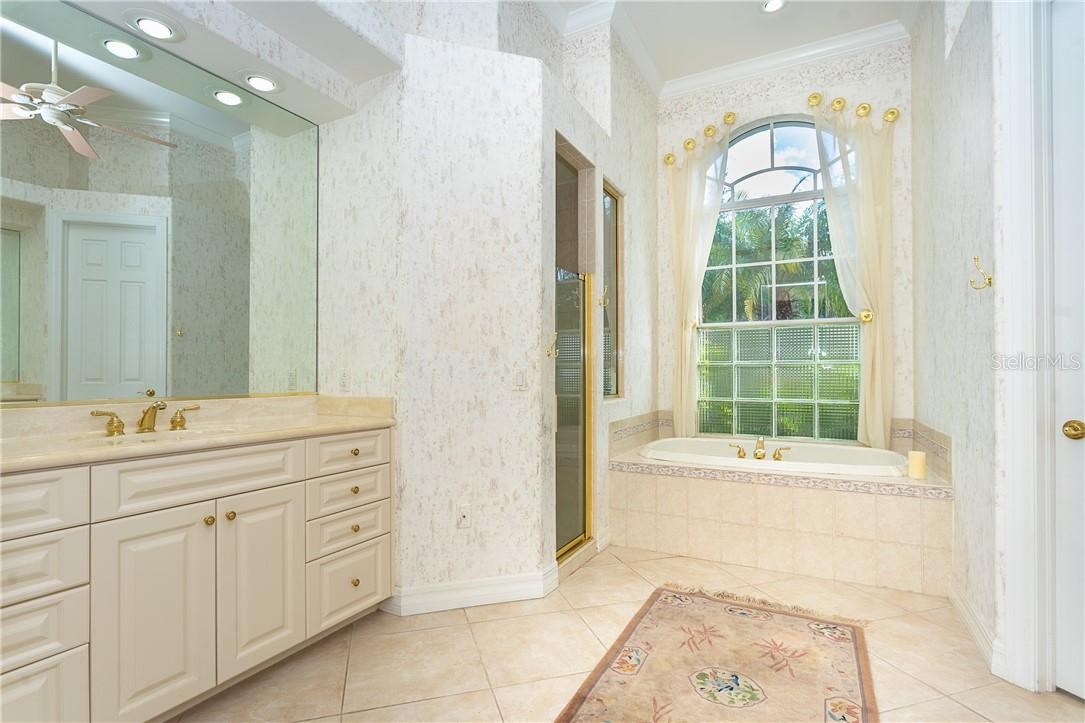 Master Bathroom with separated vanities and plenty of cabinets with large soaking tub for your relaxation at the end of a long day !!! - Single Family Home for sale at 18 Saint Croix Way, Englewood, FL 34223 - MLS Number is D6114880