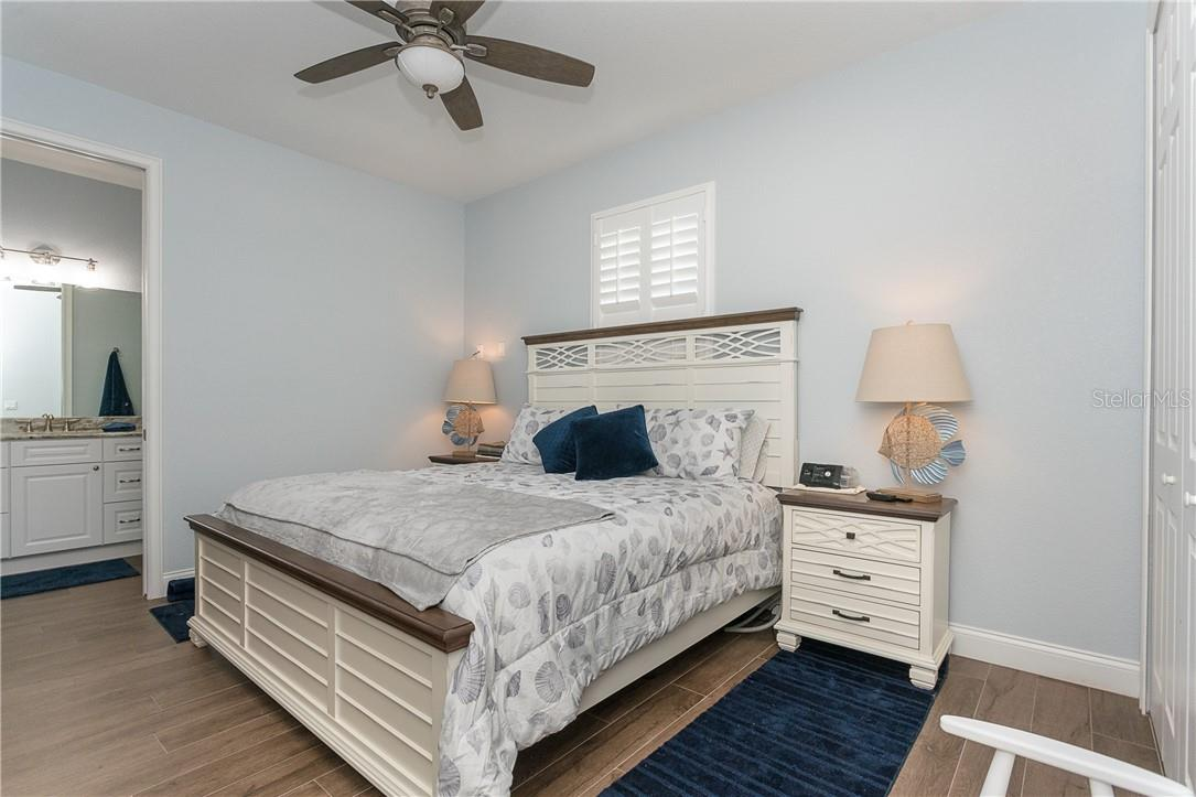 Bedroom 3 with full ensuite and direct access to the lanai - Single Family Home for sale at 145 Leland St Se, Port Charlotte, FL 33952 - MLS Number is D6117438