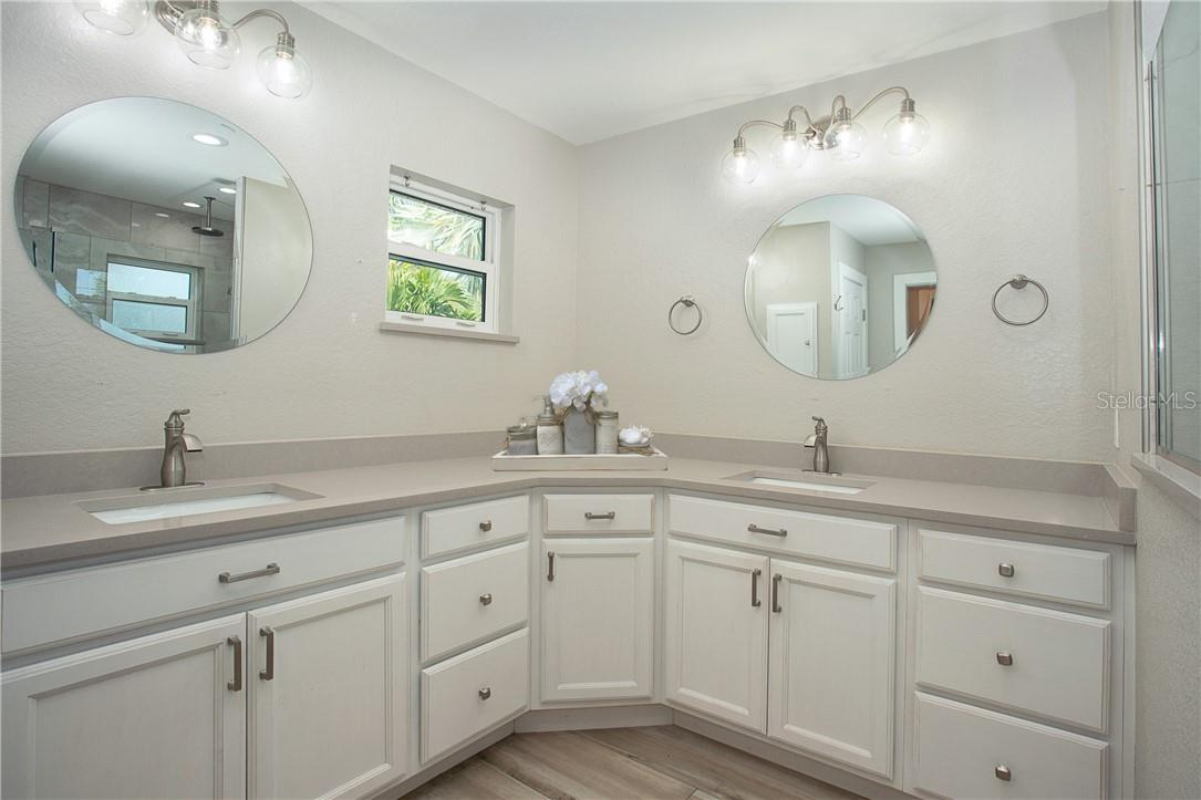 Beautiful new fixtures/mirrors and the triple drawers for each person - Single Family Home for sale at 1661 New Point Comfort Rd, Englewood, FL 34223 - MLS Number is D6117712