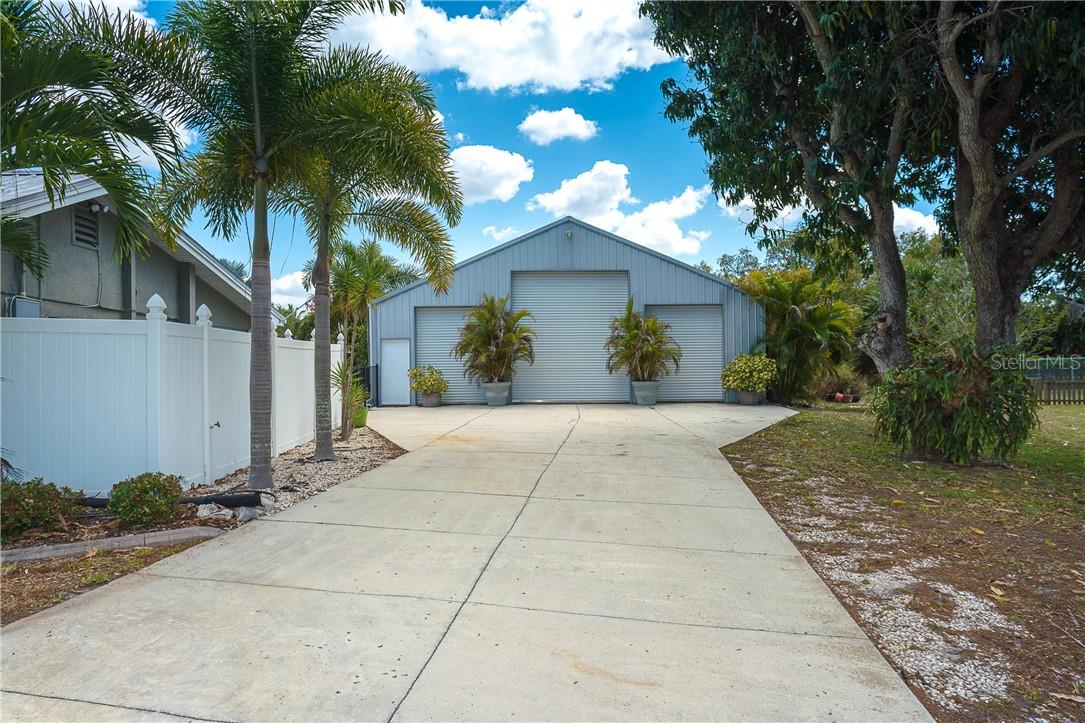 RV Garage and oversize garage doors for your boats, collector cars, RV, or any need for major storage - Single Family Home for sale at 1661 New Point Comfort Rd, Englewood, FL 34223 - MLS Number is D6117712