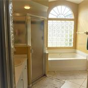 MASTER BATHROOM - Single Family Home for sale at 3657 Junction St, North Port, FL 34288 - MLS Number is D5917458