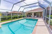 Cool off in your pool! - Single Family Home for sale at 7029 Peacock Ln, Englewood, FL 34224 - MLS Number is D5919625
