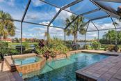 Saltwater pool with infinity spa and waterfall - Single Family Home for sale at 409 Montelluna Drive, North Venice, FL 34275 - MLS Number is D5923522