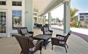 Outdoor seating at the Ibis Club - Condo for sale at 8541 Amberjack Cir #402, Englewood, FL 34224 - MLS Number is D5923680