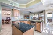 Open kitchen allows for lots of natural light and views of Lemon Creek and Amberjack Environmental Park - Condo for sale at 8541 Amberjack Cir #402, Englewood, FL 34224 - MLS Number is D5923680