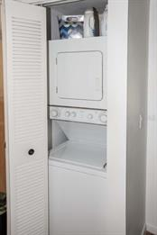 Laundry closet with stackable washer and dryer. - Condo for sale at 7070 Placida Rd #1223, Placida, FL 33946 - MLS Number is D6108523