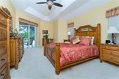 Spacious master bedroom has  a tray ceiling and sliding glass doors to the lanai. - Single Family Home for sale at 439 Boundary Blvd, Rotonda West, FL 33947 - MLS Number is D6114162