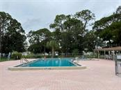 Community pool - Manufactured Home for sale at 6384 Kilepa Ct, North Port, FL 34287 - MLS Number is D6114877