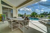 What better way to relax then next to a pool with a cool refreshing beverage in hand. - Single Family Home for sale at 12307 S Access Rd, Port Charlotte, FL 33981 - MLS Number is D6117140