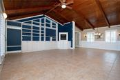 Picture your furniture in this huge open space - great for entertaining with built in's and plenty of storage - Single Family Home for sale at 1661 New Point Comfort Rd, Englewood, FL 34223 - MLS Number is D6117712