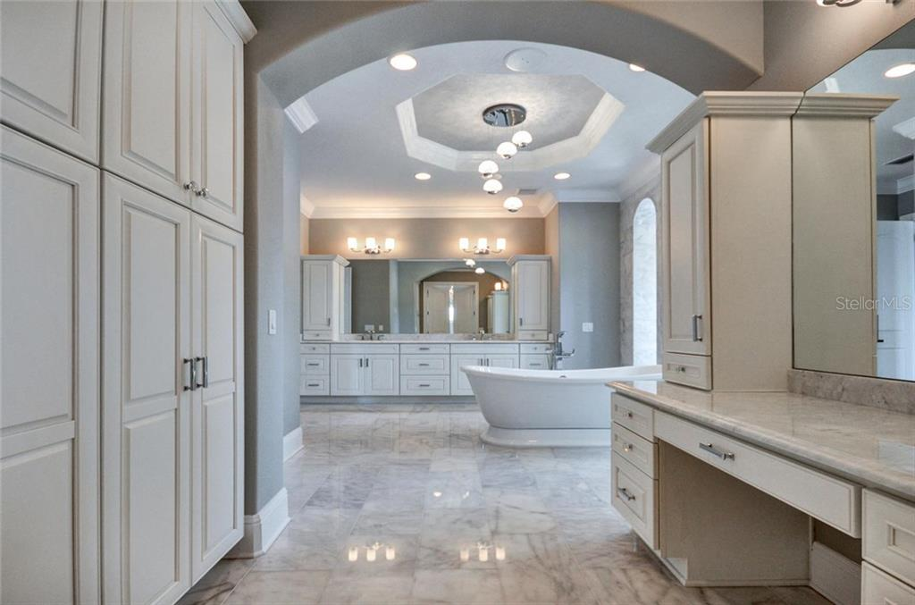 Master bath has ladies walk in closet separate vanity - Single Family Home for sale at 1400 Harbor Sound Dr, Longboat Key, FL 34228 - MLS Number is T2932520
