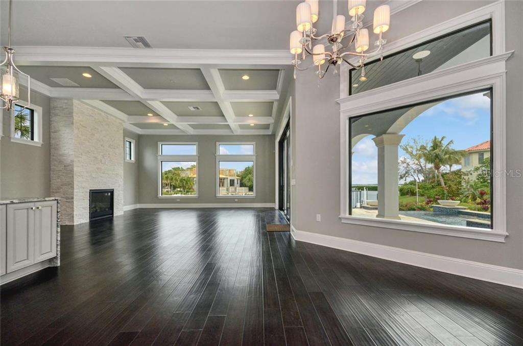 Gas fireplace. Beautiful views from all rooms - Single Family Home for sale at 1400 Harbor Sound Dr, Longboat Key, FL 34228 - MLS Number is T2932520