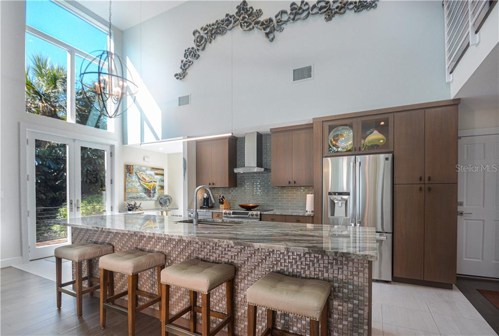 Large island and open plan kitchen - Single Family Home for sale at 140 N Casey Key Rd, Osprey, FL 34229 - MLS Number is T3228618