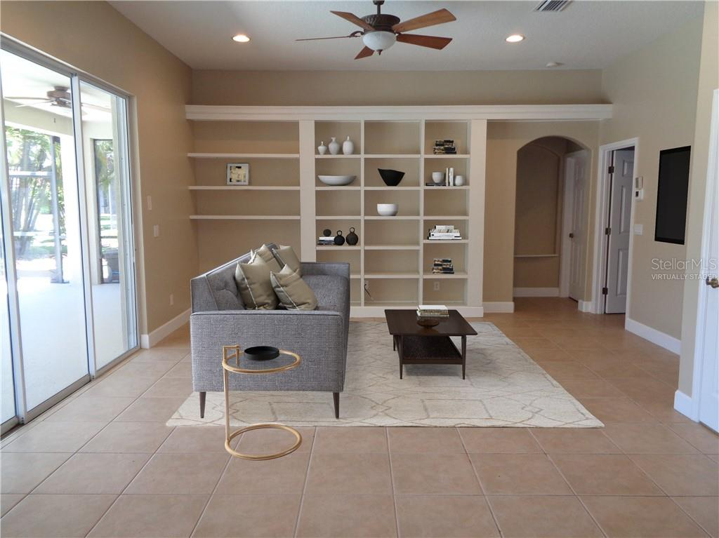 Virtually staged family room - Single Family Home for sale at 851 Placid Lake Dr, Osprey, FL 34229 - MLS Number is O5712676