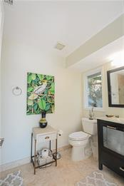 En suite bathroom for second floor bedroom.  Shower, no tub. - Single Family Home for sale at 140 N Casey Key Rd, Osprey, FL 34229 - MLS Number is T3228618