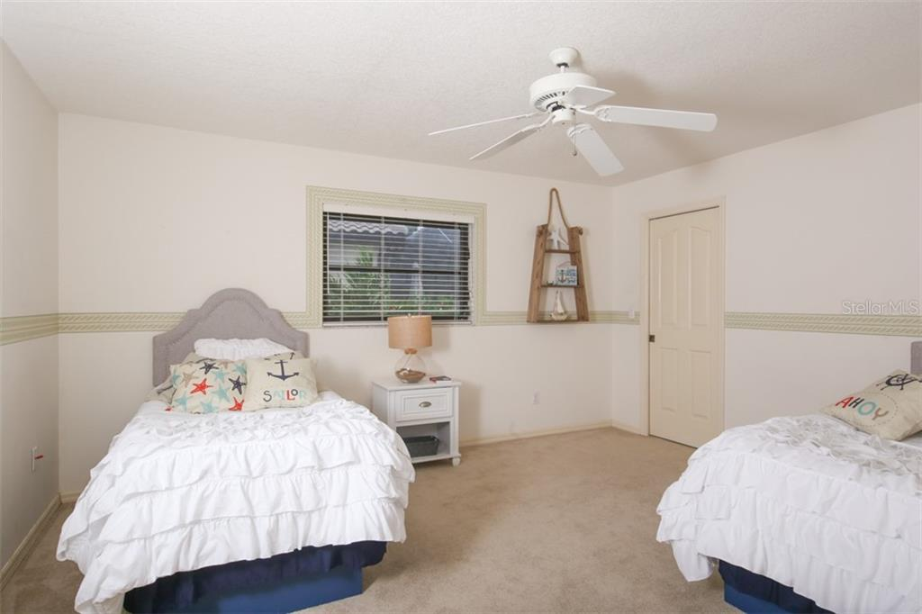 Charming guest bedroom with walk-in closet - Single Family Home for sale at 3419 Sandpiper Dr, Punta Gorda, FL 33950 - MLS Number is C7232529