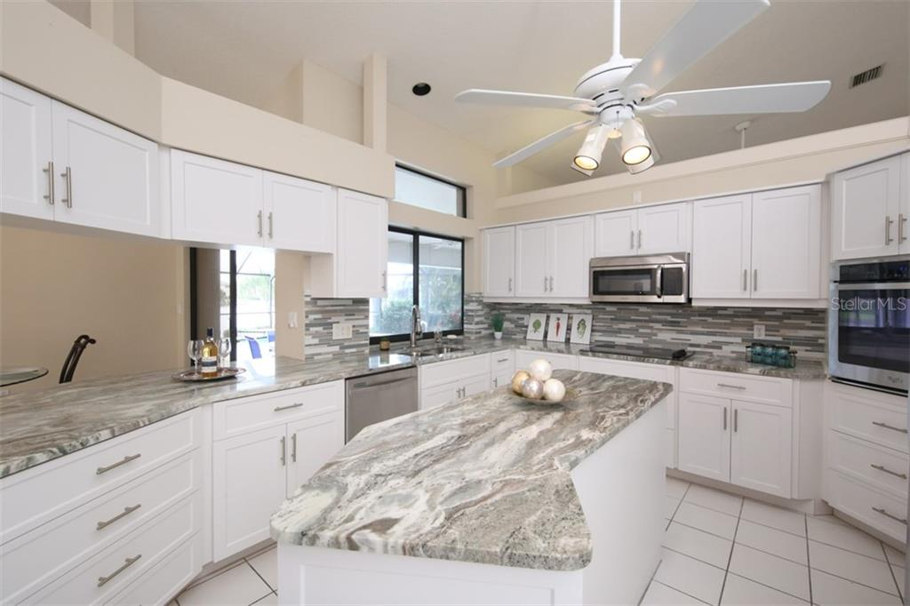 Huge center island for cooking.  Stunning view from the kitchen and pass through window looking to the beautiful outdoors - Single Family Home for sale at 3419 Sandpiper Dr, Punta Gorda, FL 33950 - MLS Number is C7232529