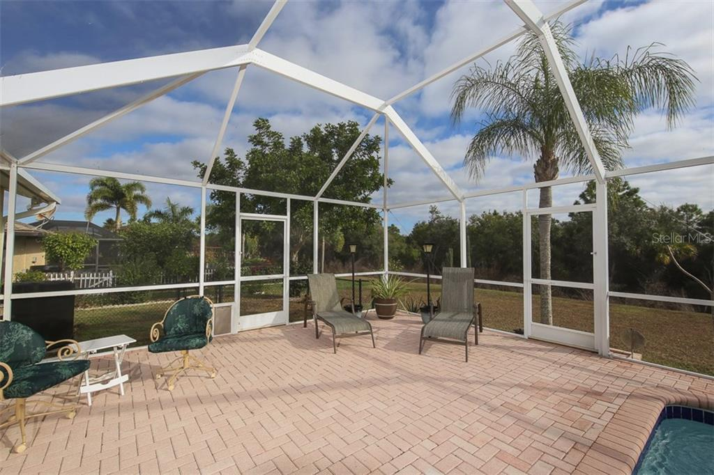 Expansive paver pool deck with plenty of room for relaxing - Single Family Home for sale at 2332 Mauritania Rd, Punta Gorda, FL 33983 - MLS Number is C7234250
