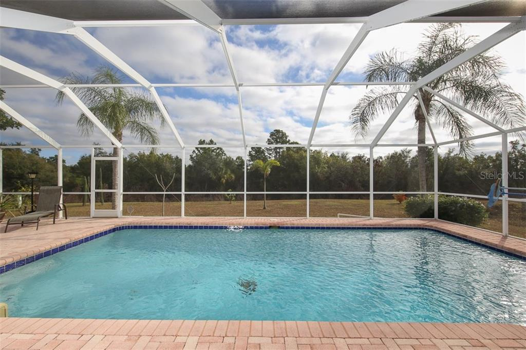 Tropical oasis poolside - Single Family Home for sale at 2332 Mauritania Rd, Punta Gorda, FL 33983 - MLS Number is C7234250