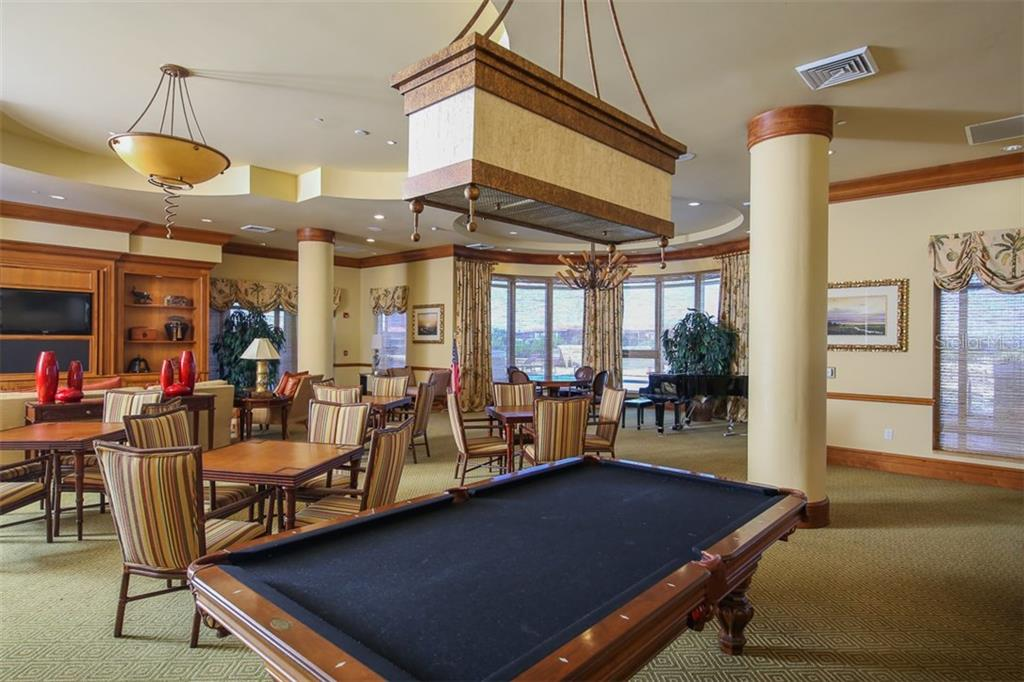 Grand Salon with game tables, billiards, wide screen TV and full bar/catering kitchen.  A great place for residents to gather for social functions or possibly you might wish to utilize this for a private function. - Condo for sale at 3313 Sunset Key Cir #402, Punta Gorda, FL 33955 - MLS Number is C7236886