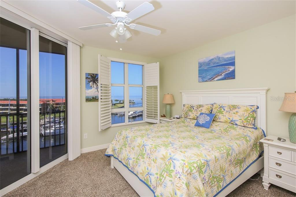 You will wake up each morning to delightful water views that will certainly put a smile on your face!  Newly installed carpet with memory foam padding will indeed be a treat for your feet!  Linen closet, walk-in closet and private bath completes the master retreat. - Condo for sale at 3313 Sunset Key Cir #402, Punta Gorda, FL 33955 - MLS Number is C7236886