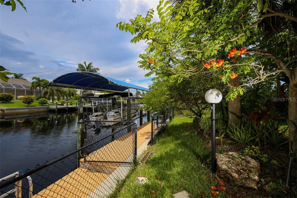150' of concrete seawall, 36' composite deck, with new 7K boat lift, canopy cover, cables and steel beam, and 2 new outside pilings. - Single Family Home for sale at 17296 Foremost Ln, Port Charlotte, FL 33948 - MLS Number is C7240998