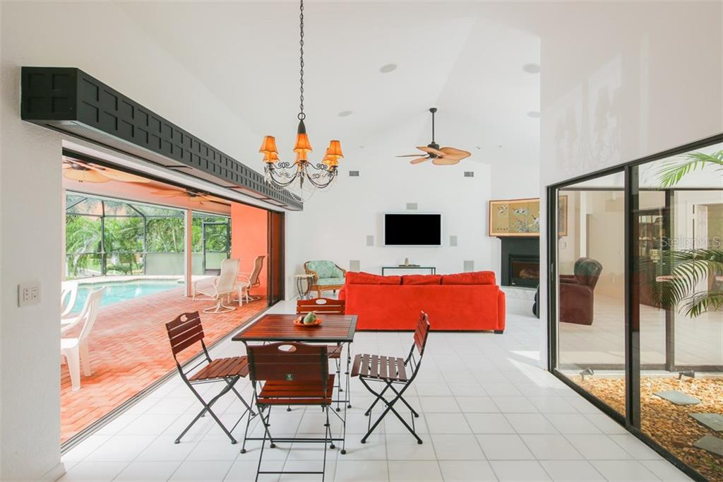 Dining area is open to the great room with an atrium that brings in tremendous light - Single Family Home for sale at 1620 Appian Dr, Punta Gorda, FL 33950 - MLS Number is C7242315