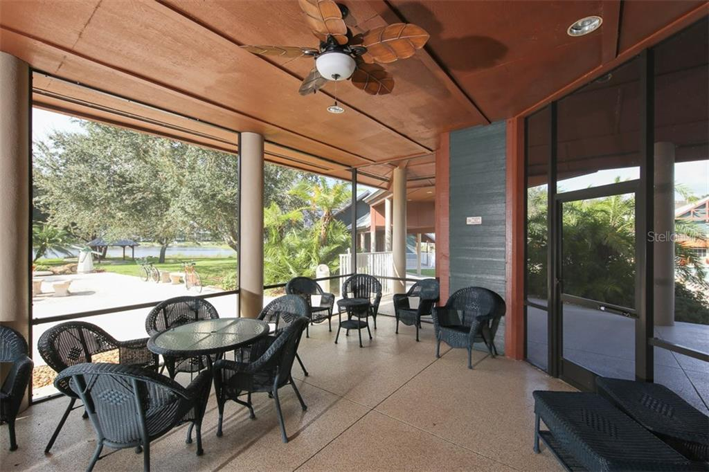 Part of the outdoor patio of the clubhouse overlooking the lake - Villa for sale at 1268 Green Oak Trl, Port Charlotte, FL 33948 - MLS Number is C7243755