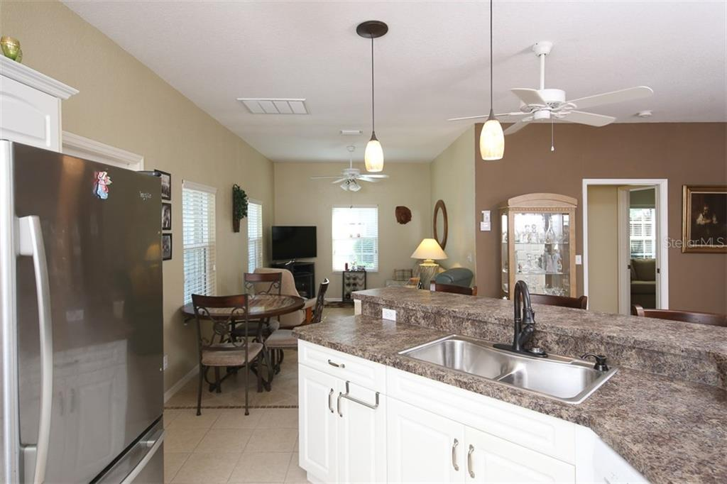 Kitchen opens up to a small bonus room that was opened up for greater flex space - Villa for sale at 1268 Green Oak Trl, Port Charlotte, FL 33948 - MLS Number is C7243755