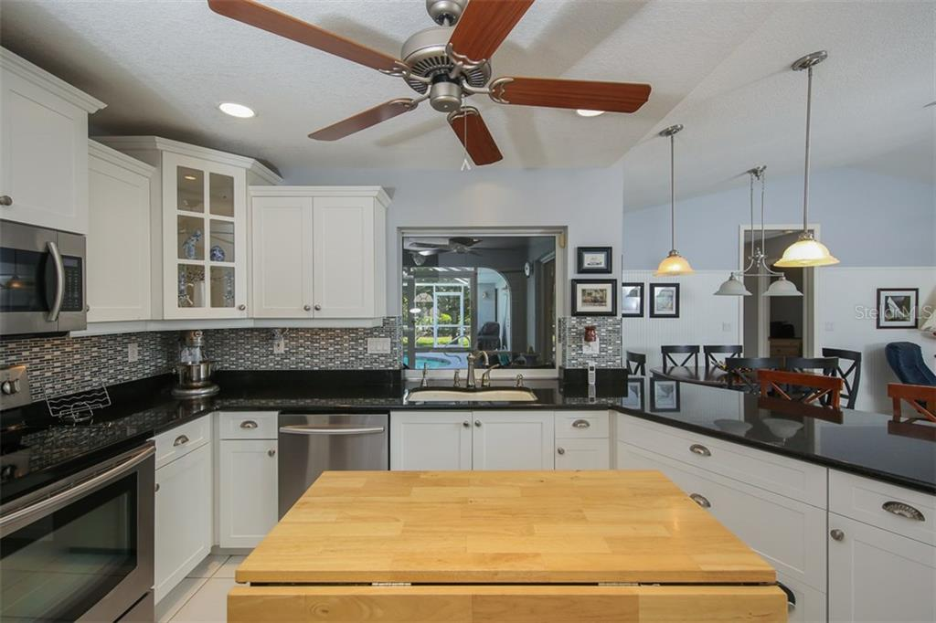 Beautiful backsplash in kitchen.  Enjoy the view out the pass through in the kitchen - Single Family Home for sale at 4407 Albacore Cir, Port Charlotte, FL 33948 - MLS Number is C7245070