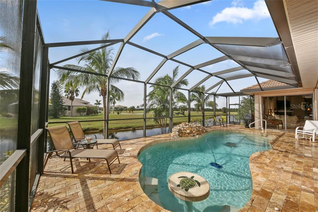 Gorgeous stone compliments the inviting outdoor area.  Relax on a chaise lounge or pour yourself a cool drink and sit around the submerged cocktail table.  It has to be 5 O'clock somewhere! - Single Family Home for sale at 17208 Barcrest Ln, Punta Gorda, FL 33955 - MLS Number is C7245458