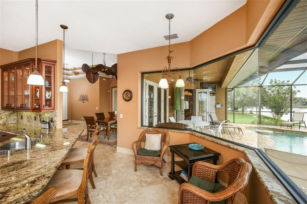 Aquarium windows envelope the café area while providing natural lighting and scenic views! - Single Family Home for sale at 17208 Barcrest Ln, Punta Gorda, FL 33955 - MLS Number is C7245458