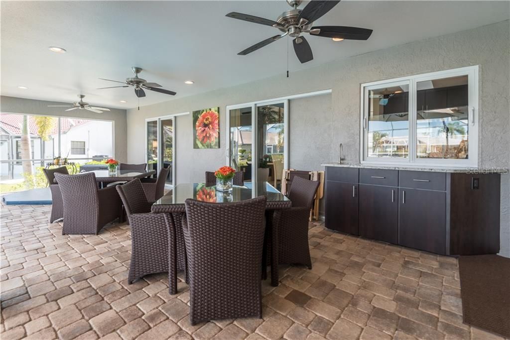 Large covered lanai space with brick pavers and built in cabinets make entertaining easy. - Single Family Home for sale at 2510 Rio Largo Ct, Punta Gorda, FL 33950 - MLS Number is C7246934