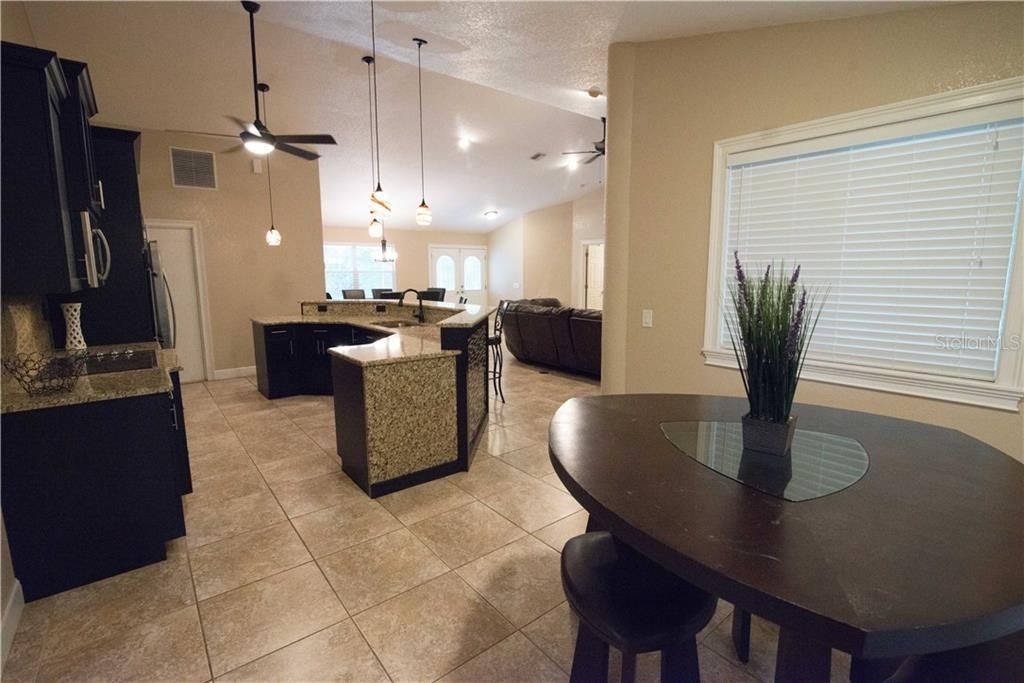 Double ovens, new Samsung microwave and dishwasher, new 42-inch cabinets... everything you need to show off your culinary skills. - Single Family Home for sale at 3184 Ulman Ave, North Port, FL 34286 - MLS Number is C7400587